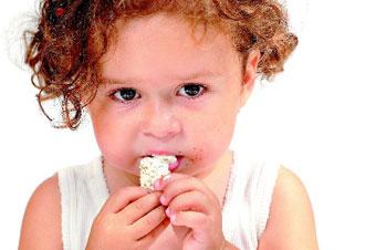 toddler eats a candy