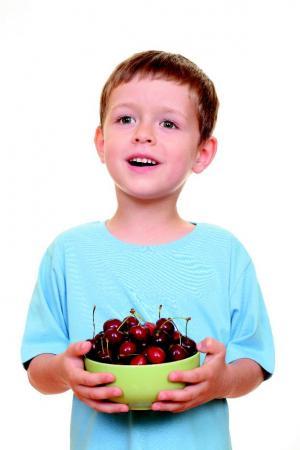 child with cherries