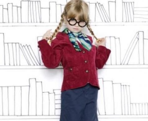 girl in front of painted books