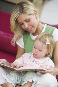 mom and baby reading together